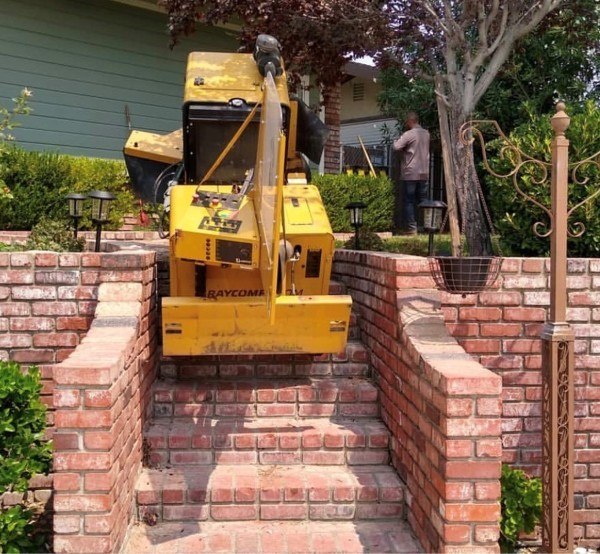 Stump Grinder Adjustable Tracks as narrow as 36 inches. Climbs stairs too.